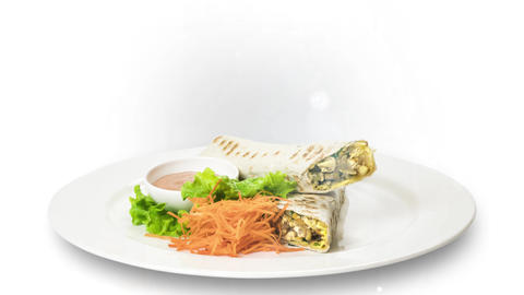 Shawarma served with sauce and carrot on white plate on white background Live Action