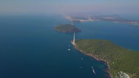 Scenic aerial view of blue ocean and islands with aerial tramway or aerial Live Action