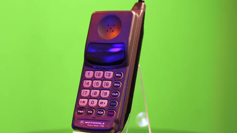 Motorola Pocket Classic 1100 GSM Mobile Telephone on Green Screen Background Live Action