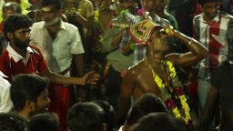 Devotees dancing in crowd at Hindu festival in Sri Mutharamman Temple Footage