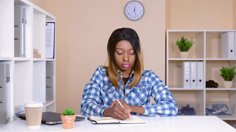cheerful worker in startup company write to do list Live Action