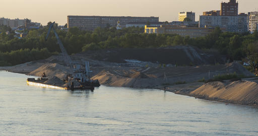 barge crane works at bank of industrial district near river GIF