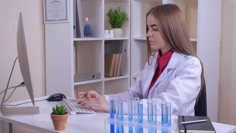 young professional medical scientist working in the office ライブ動画