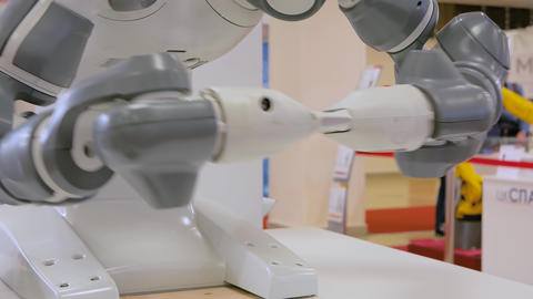 Close up view of moving futuristic robotic clamp arms at robot exhibition Live Action