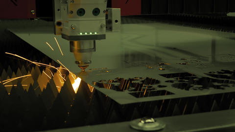 Automatic cnc laser cutting machine working with sheet metal with sparks Live Action