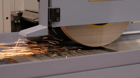 Surface grinding wheel machine working with sheet metal at factory Live Action