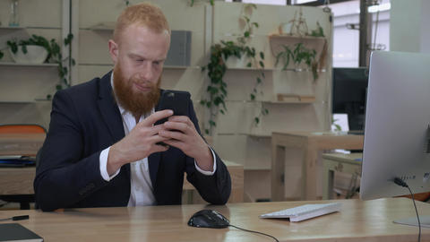 businessman using smart phone indoors Live Action