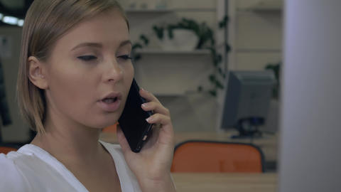 young professional worker has phone conversation at work Live Action
