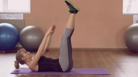girl doing physical exercises for strong lower abs ライブ動画