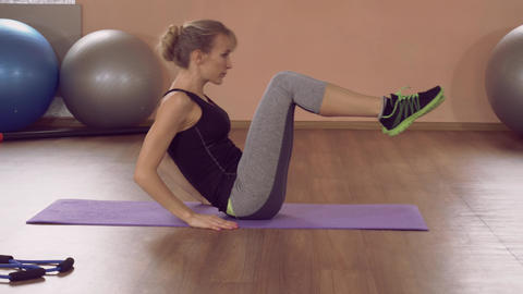 girl doing physical exercises for toned abs ライブ動画