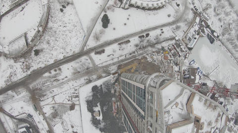 View on the city in the background of a construction site, FPV drone flight Live Action