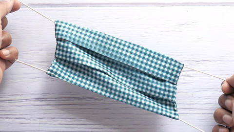 Top view of man hand holding homemade face mask ライブ動画