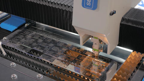 Laser cutting machine working with sheet metal with sparks at exhibition Live Action