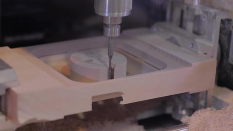 Milling machine cutting wooden workpiece from wood pulp at technology exhibition Live Action