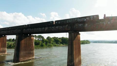A Train Trams Crossing A Railroad Bridge Over A River ライブ動画
