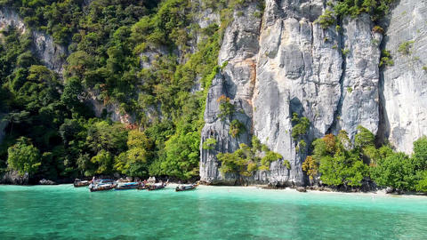 Amazing aerial view of Monkey Beach in Phi Phi Islands, Thailand Live Action