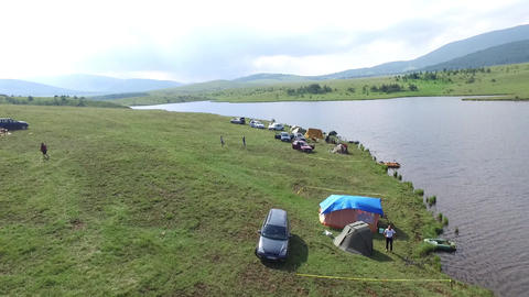 Zlatibor Mountain, Serbia. Cars and Tents on Camping Lake Area, Aerial View Live Action