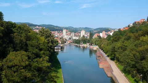 Uzice City, Western Serbia. Aerial View of River Dam Beach and Cityscape Live Action