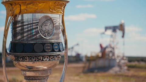 cup with Yuri Gagarin against pump jacks in oil field ライブ動画