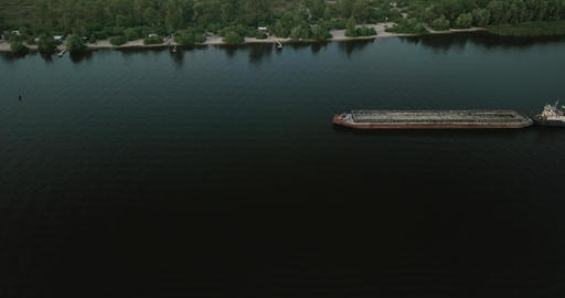 Drone flight over the river by ships walking along it on a cloudy day. Ukraine ライブ動画