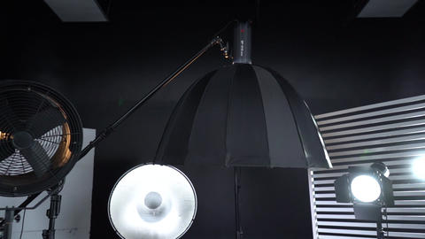 Modern photo studio with professional lighting equipment Dark room cyclorama 5 Live Action