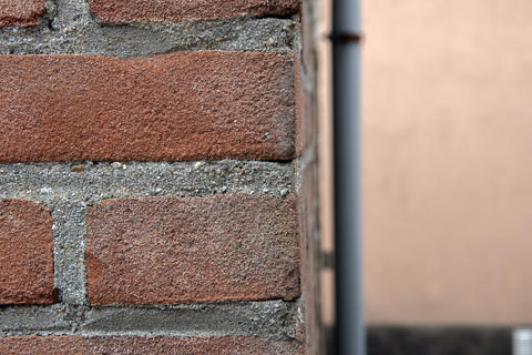Close Up Brick Wall And Water Pipe At The Background At Amsterdam The Netherlands 15-6-2020 フォト