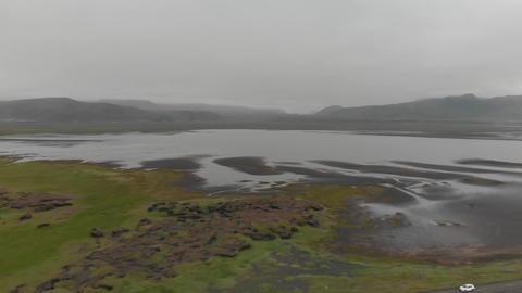 Aerial panoramic view of Reynisfjara coastline and mountains in summer season ライブ動画