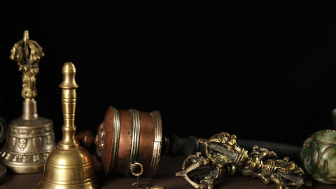 Tibetan singing copper bowl with a wooden clapper on a brown wooden table, objects for meditation ライブ動画