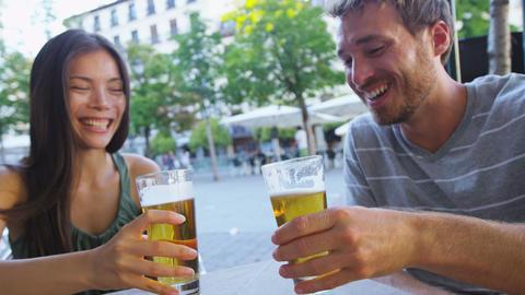 Couple eating tapas drinking beer in Madrid Spain ライブ動画