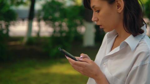 profile female walks use mobile slow motion Live Action