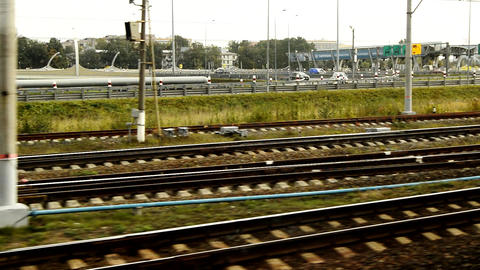 View from the train window on the city highway with cars, scrap, the train departs from the Baltic Live Action