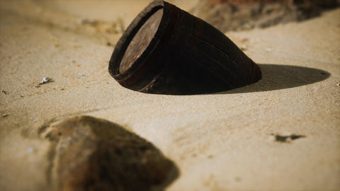 Old wooden barrel on the beach GIF