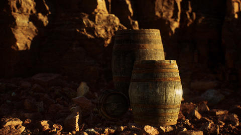 old wooden vintage wine barrels near stone wall in canyon GIF