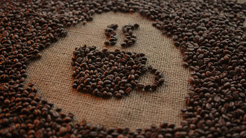 Pictogram of smoking hot coffee cup drawn from roasted coffee beans on jute ライブ動画