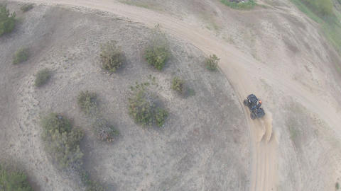 Extreme sport, ATV racing off-road, high speed with lots of dust, FPV drone Live Action