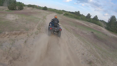 Racer on an ATV is driving off-road on high speed, dynamic FPV drone footage Live Action