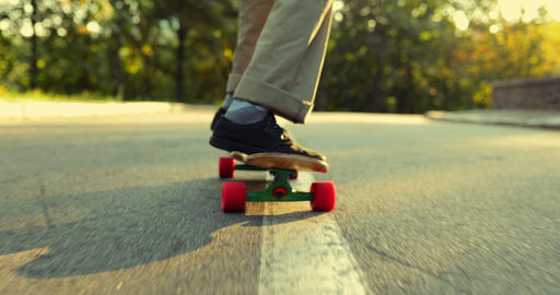 Man performs a trick on a skateboard, longboard. View from below Live Action