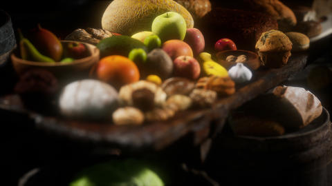 food table with wine barrels and some fruits, vegetables and bread GIF