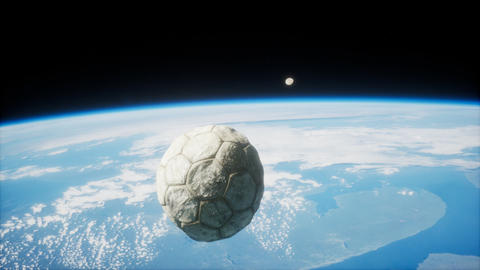 old soccer ball in space on Earth orbit GIF