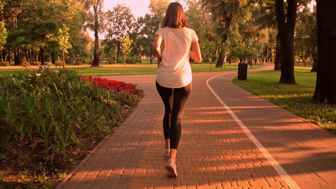 unrecognizable female running in city healthy lifestyle Live Action