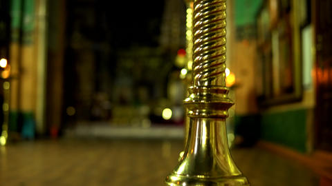Golden floor candlestick in the Orthodox Church with one burning candle Acción en vivo