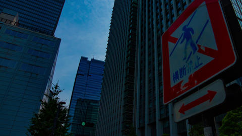 A timelapse of cloud at the business town in Tokyo wide shot panning GIF