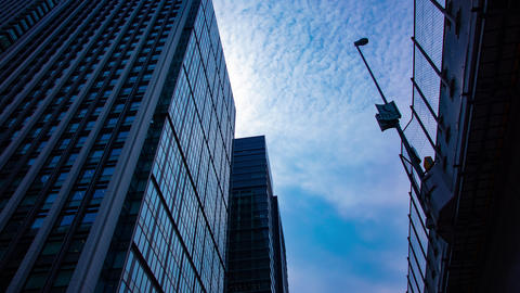 A motion timelapse of cloud at the business town in Tokyo wide shot GIF