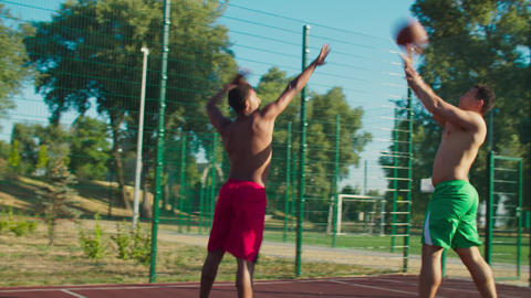 Streetball player scoring points after pump fake GIF