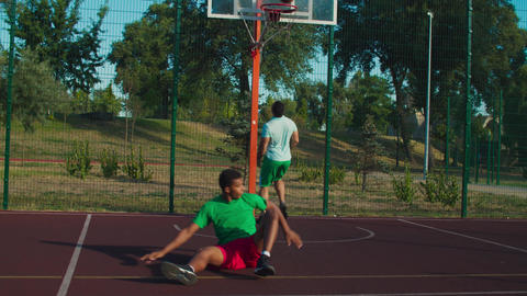 Street basketball player committing offensive foul GIF
