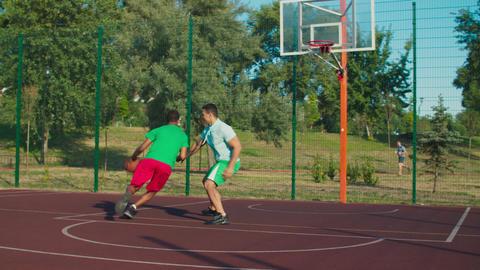 Street basketball players playing half court game GIF