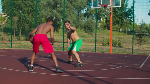 Shirtless basketball players in action on court GIF