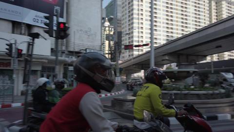 Bangkok Thailand - April 06, 2020: Biker start from junction under highway with ライブ動画
