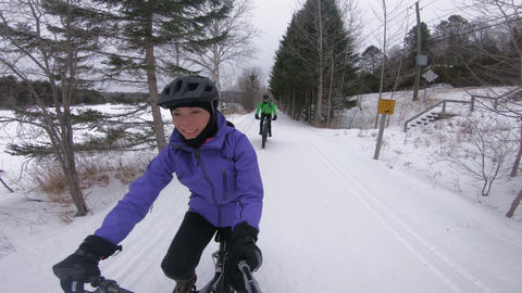 Fat bike in winter. Fat biker riding bicycle in the snow in winter. Selifie Live Action