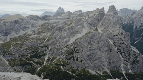Mountaineering on the famous via ferrata Alpinisteig and Sexten Dolomites mountain panorama in South Live Action